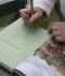 L.Lancmane sniedz autogrāfus